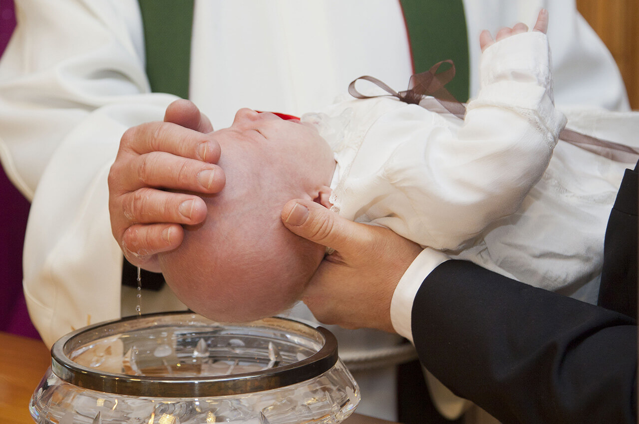 Baby Being Baptised by Priest