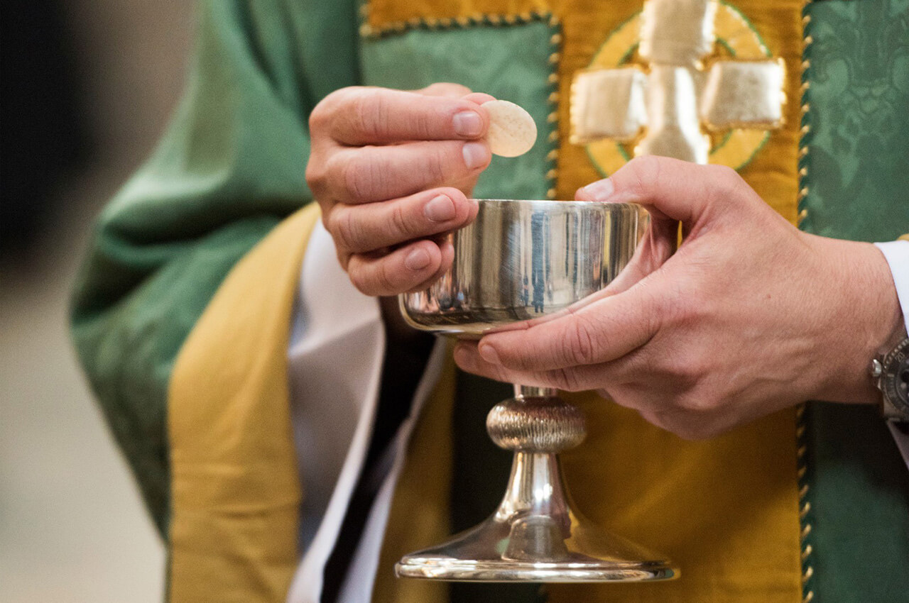 Priest Holding Eucharist