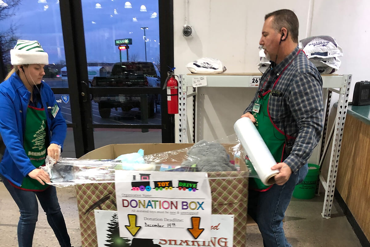 Man and Woman Collecting Toy Drive Donations