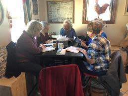 Women Studing Bible Around Table