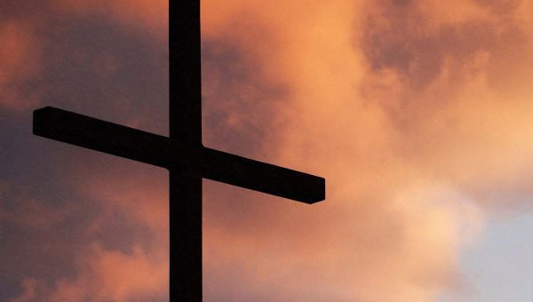 Cross with Clouds at Sunset in Background