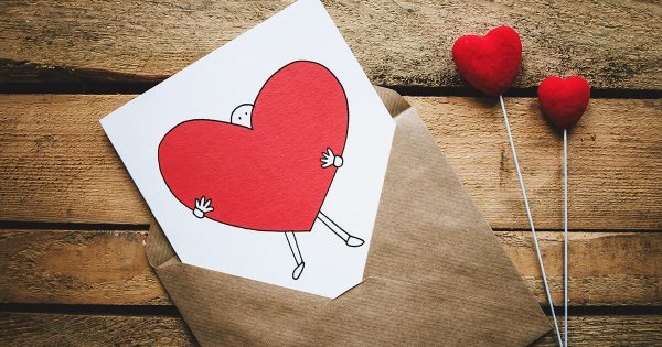 Valentine Card with Person Holding Giant Heart