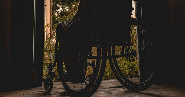 Wheelchair Silhouette in Doorwar