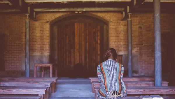 Parishioner Waiting in Pews For Reconciliation