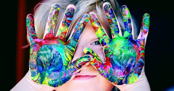 Child with Colorful Paint on Hands